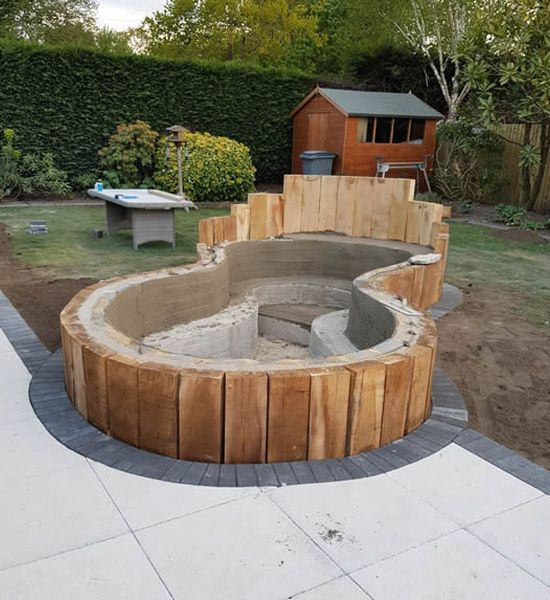 koi carp pond installed alomng with patio for local bournemouth customer